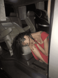 Woman sleeping in the backseat of a car