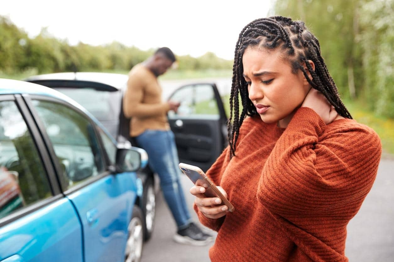 woman calling car accident lawyer after collision